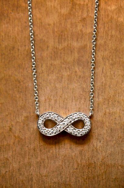 This romantic piece features shimmering pavé diamonds.