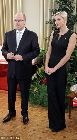 Prince Albert looked dapper in a classic suit and dove grey tie