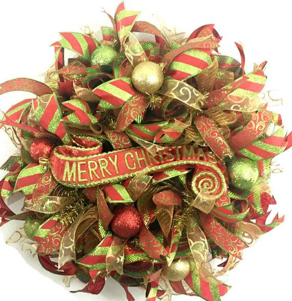 This red, lime green and gold deco mesh wreath will look brilliant on your front door There is nothing better than having a Christmas wreath making walking into your home warm and welcoming. https://www.etsy.com/listing/163815638/deco-mesh-wreaths-for-sale-mesh