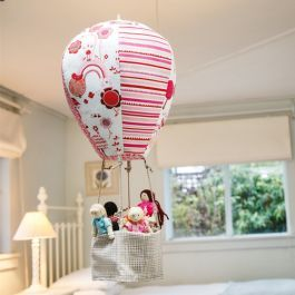 A fun gift for a girl or boy made up in their favourite colours, this hot air balloon mobile pattern from Louise Papas will hold a small toy or doll.  www.cosyproject.com