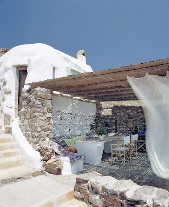 This gorgeous place is the Villa Drakothea on the Greek Island of Mykonos.  photographed by francesco lagnese for le figaro
