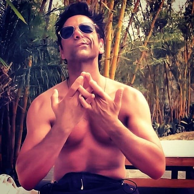 Pin for Later: The Sweetest and Silliest Celebrity Candids From 2014  John Stamos did some shirtless meditating in India. Source: Instagram user johnstamos