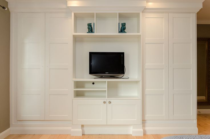 Using IKEA's PAX closet system, we were able to make these stylish custom, built-in wardrobes for a fraction of the cost.