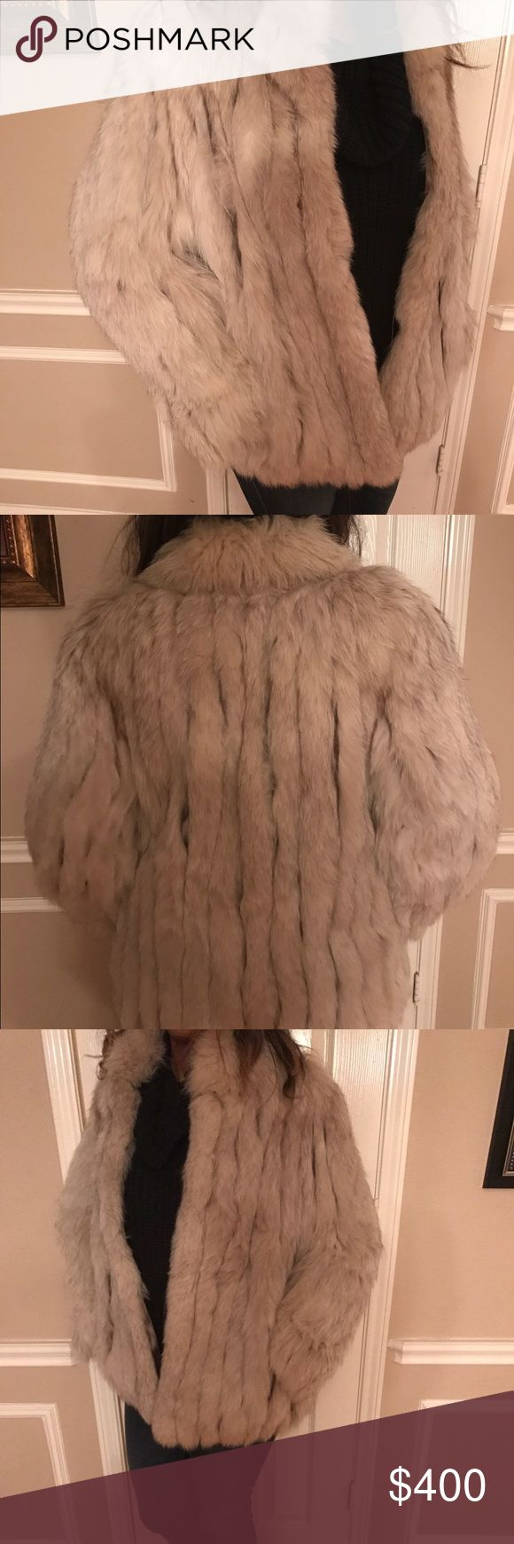 Vintage Scandinavian Blue Fox Fur Coat In very good pre-owned condition from my grandmother. This beautiful Saga Silver Fox jacket is made with alternating strips of beautiful silver tipped fox and ivory suede which makes it a more slimming fox fur jacket than most.  It is lined with a beautiful gold 100% acetate material that is in near perfect condition. Hidden side pockets. The size of the coat is a Large. Price is $400 or best offer.  Please note: color shown in photos may not be exact…
