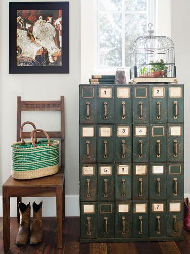 A mail-room cabinet, scored at a vintage shop, strikes an industrial note this mudroom. #bargain #decorating