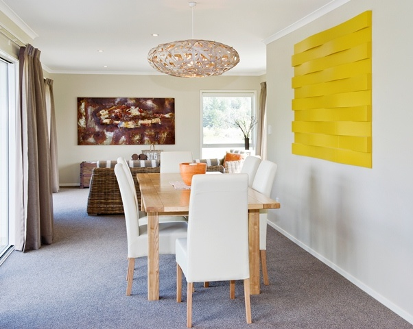 Funky light shade and vibrant art brings this dining area to life.