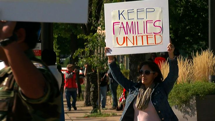 """In Minneapolis on Wednesday, protesters gathered outside Sen. Amy Klobuchar's office voiced their opposition to the deportations. They held signs. Some raised by children read: """"Keep my dad home."""""""