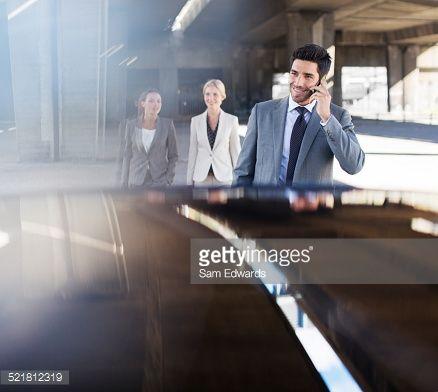 Stock Photo : Business people walking in parking garage