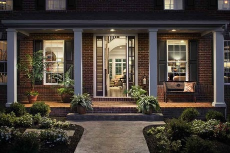 Welcome Home Four Pillars And Exquisite Landscaping Lead To A Brick Front Porch At Dusk The
