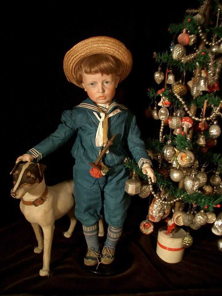 Decorated small feather tree with a German doll and toy candy container, dog. (Kammer & Reinhardt Dolls 107)