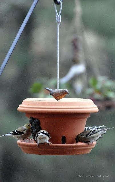 DIY Flowerpot bird feeder ~ site also has how to make wine bottle birdfeeders...