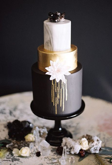 Three-Tiered Black, Gold, and Marble Wedding Cake. This creative confection is a trifecta of chicness with its three tiers in black, gold, and marble hues. Created by Sweet and Saucy Shop.
