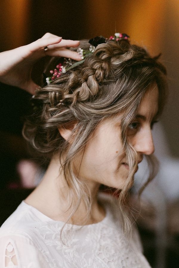This braid and flower crown add a boho element to a fall wedding