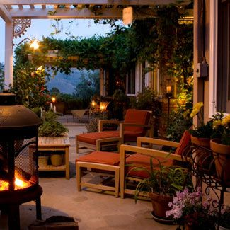 This outdoor room is lovely - pergola, fire pit, chaise lounges for napping. All it needs is me + a bottle of wine.