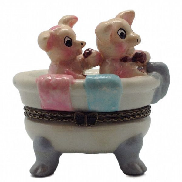 The timeless hinge box has been popular for decades as a kids gift or collectible used for jewelry, rings or trinkets. This hand painted pigs in a bathtub jewelry box is made of ceramic. - Approximate