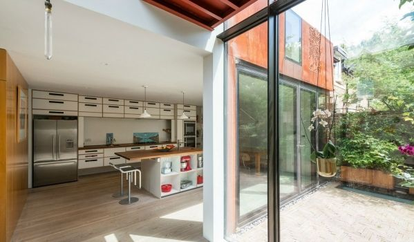 Kitchen opening out onto courtyard