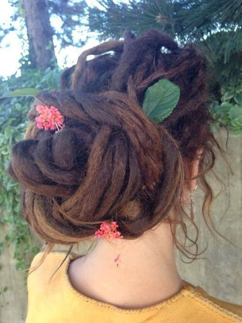 I like sticking leaves and sometimes flowers in my dreads, or just in my hair in general I guess