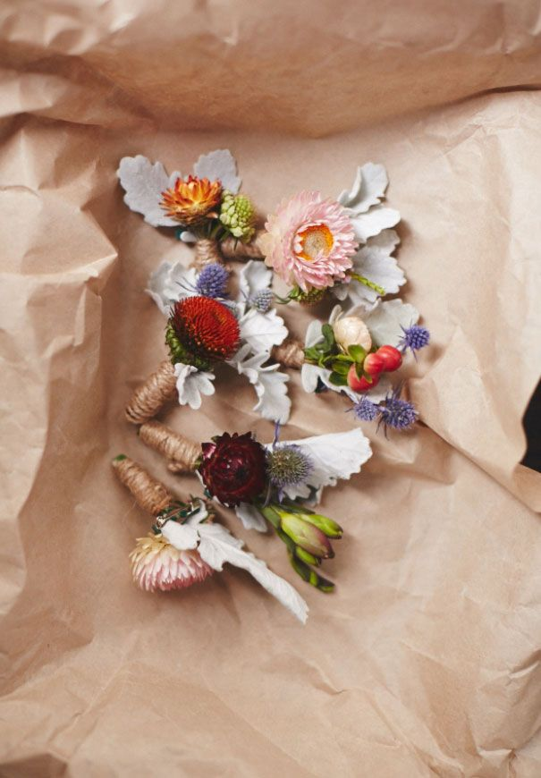 Gorgeous corsages with a handmade feel. Loving the twine and use of so many unique flowers.