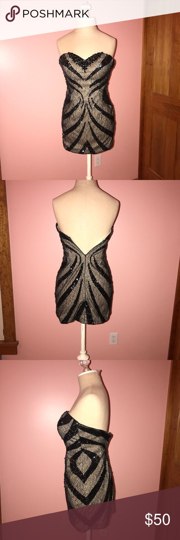 Cinderella Divine Homecoming Dress Black and nude mini dress with gem and sequin designs throughout. Worn once, in great condition. Runs small fits more like a 4!! Dresses Strapless