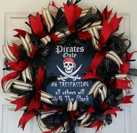 "This is a really cool pirate wreath. The sign says ""Pirate's only, no trespassing, all others will walk the plank"". It's made to order, and will ship within 1-3 business days. It's approximately 25""-2"