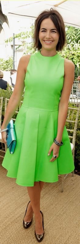 Who made Camilla Belle's neon green dress and blue handbag?
