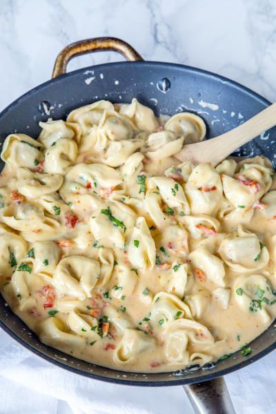 Creamy tomato basil tortellini makes a rich dinner the whole family will love. Pasta tossed in a sun-dried tomato cream sauce with plenty of fresh basil is where it's at!