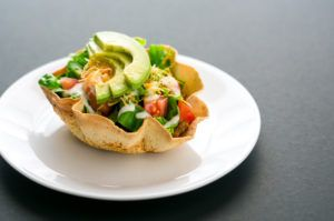 Mini Chicken Taco Salad Bowls make up for their size with mighty flavor. Protein-packed to fill you up in just 190 calories. Get the healthy recipe here.
