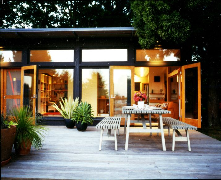 replace sliders with double doors and step out onto a wood deck that stretches the length of the house