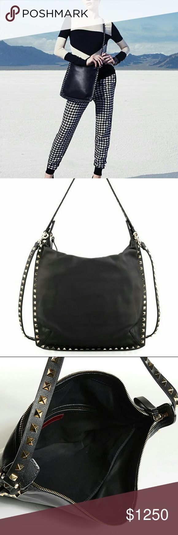 """SALE!! VALENTINO Rockstud Leather Hobo Bag 100% Authentic Valentino Rockstud  w/signature Rockstuds in soft vitello leather + platino hardware. Studded hobo strap + removable crossbody strap for versatility = two ways to carry!  Two-compartment interior, cotton canvas lining w/interior one zip + two slip pockets, 11.5""""H x 12""""W dimensions.  Gently used, light scratches/indentions from occasional wear, missing pull tab at main zip compartment. Interior is super clean, all studs intact…"""
