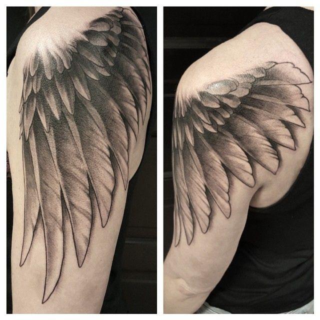Realistic wings tattoo