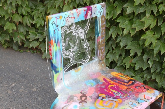 The Frenchie: hand made one-inch-thick acrylic Form chair with hand carved French Colonial acrylic seat back and hand painted by Aaron R. Thomas