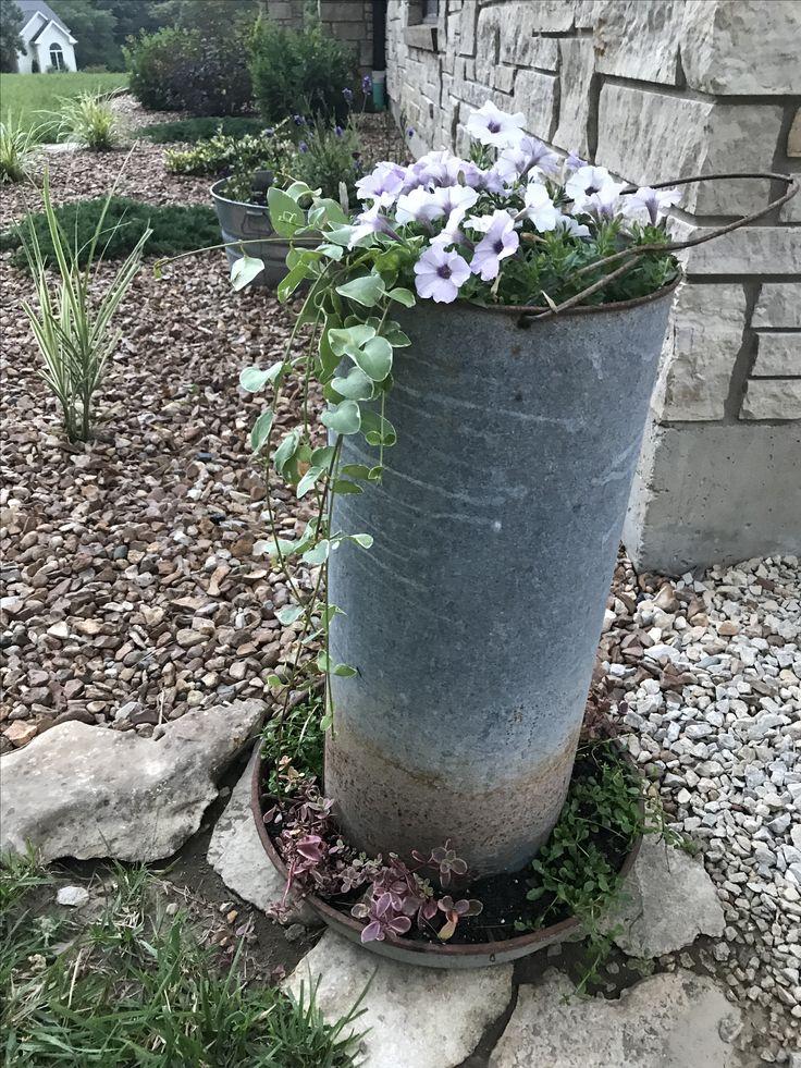 $11 thrift store find!  Love my chicken feeder turned flower planter.  Joanna Gaines style!