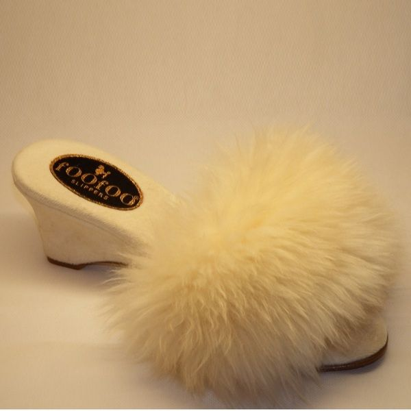 This classic foofoo mule slipper has a rich fluffy cream sheepskin top. With the classic scooped wedge heel, it is elegant, classy & unique. The material is a beautiful rich velvet, & the fact that its hand made by a true craftsman makes it the perfect slipper.