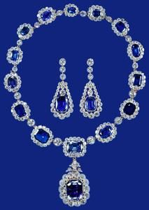 Sapphire and diamond suite of necklace and earrings, Mid-19th century; altered 1952 and 1959 by Garrards. Purchased by King George VI from Carrington & Co and given to Princess Elizabeth as a wedding present in 1947.