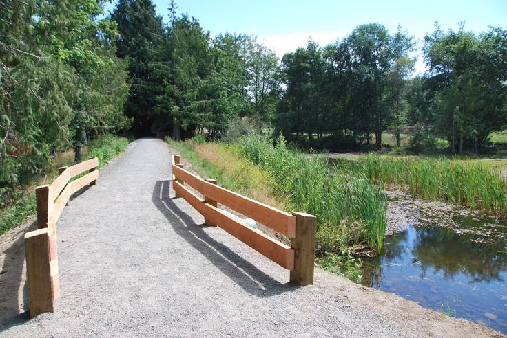 Walking trail by the pond at Woodland Creek Park, Sooke BC