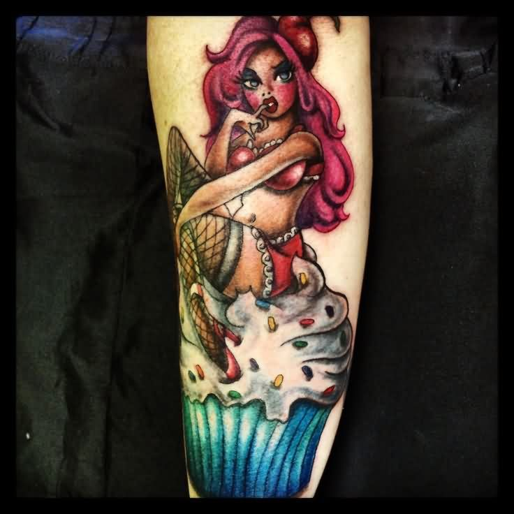 Sweet Pinup Girl On Cupcake Tattoo