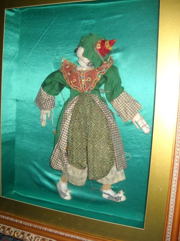 Antique marionette in a shadow box