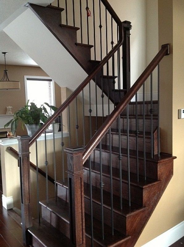 Oak staircase with wrought iron pickets Oak staircase with wrought iron pickets Photo posted by Pine Glen General Contractors Inc. located in Oakville