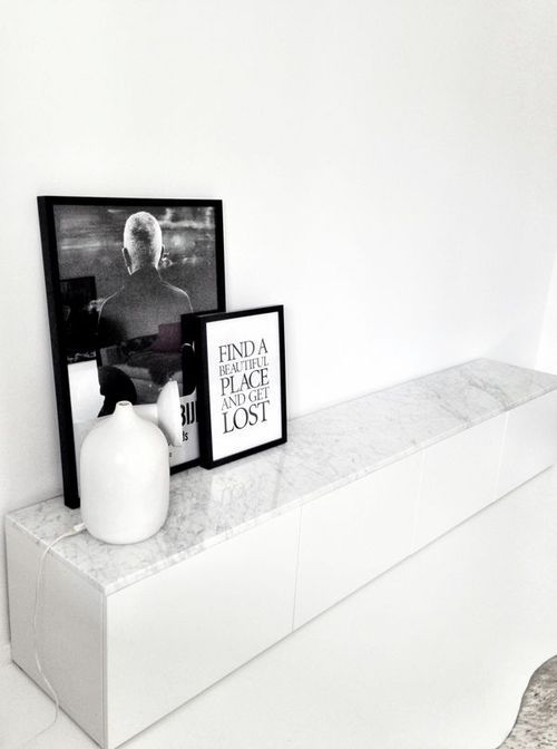 Great minimalist approach. Great use of a soft white touch highlighted by different items using a black tone to make the area pop out at you.