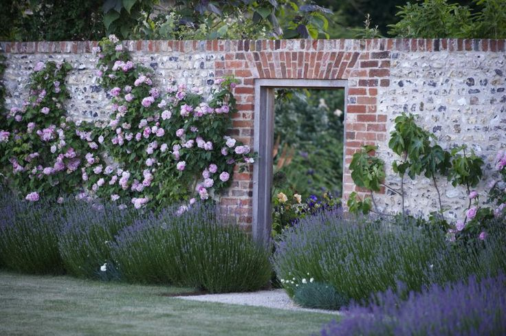 Lavender and roses... glorious combination... :) The scents, combined--utterly enticing.  Lovely entry to the garden, and you don't need a brick wall to make this happen.