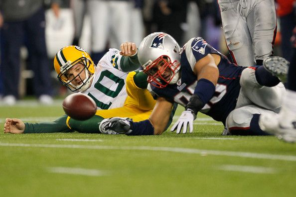 Tully Banta-Cain Photos Photos - Quarterback Matt Flynn #10 of the Green Bay Packers fights for possession of a loose ball after being sacked by linebacker Tully Banta-Cain #95 of the New England Patriots during the fourth quarter of the game at Gillette Stadium on December 19, 2010 in Foxboro, Massachusetts. The Patriots won the game 31-27. - Green Bay Packers v New England Patriots