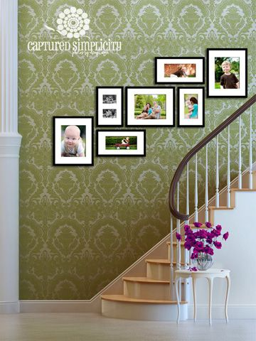 Stairs with framed grouping. Photography courtesy of Amy Vecchio