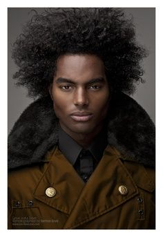 A Black Man With Natural Long Hair