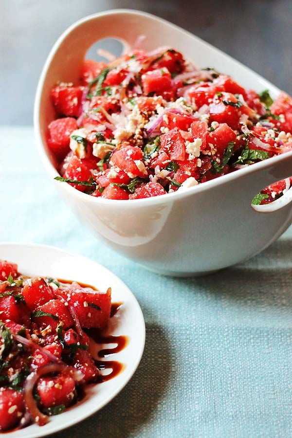 Watermelon and Feta Salad with Balsamic Reduction.  A bit of an unusual combination, but the sweetness of the watermelon mixed with the saltiness of the feta, a little bite of onion all drizzled with tangy sweet balsamic reduction works like magic on your plate.