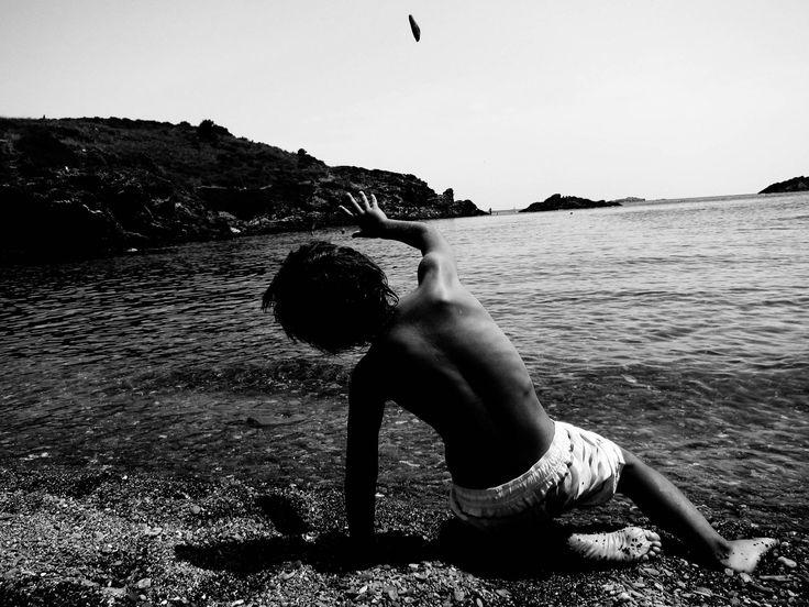 Costa Brava stone beach throwing by Oriol Lloret on 500px