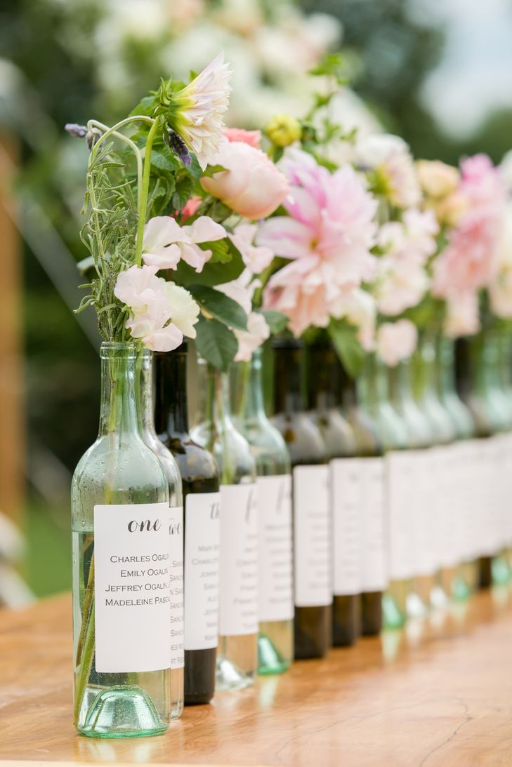 Wine Bottle Bud-Vase Table Assignments | Melani Lust Photography https://www.theknot.com/marketplace/melani-lust-photography-westport-ct-540738 | Hana Floral Design https://www.theknot.com/marketplace/hana-floral-design-mystic-ct-292738