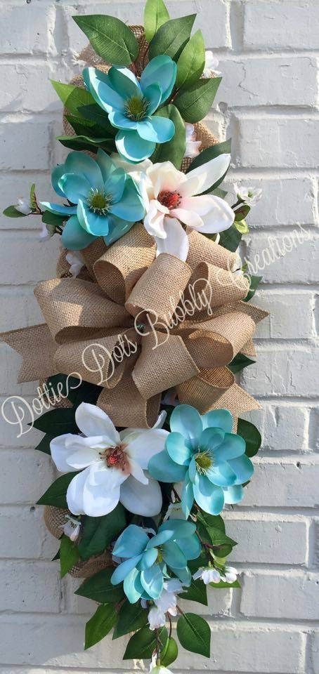 Teal & Cream Magnolia Burlap Swag, Magnolia Swag, Magnolia Wreath, Magnolia Swag, Everyday Wreath This is a Teal & Cream Magnolia Burlap Swag, accented with dogwood flowers, ficus leaves and a burlap bow arranged on a 24 strip of lattice covered with burlap material, this swag would be great to use everyday, can be used on a door, wall, over a picture, door or anywhere you choose to use it. The swag measures approximately 13W X 33H X 8D. In Stock