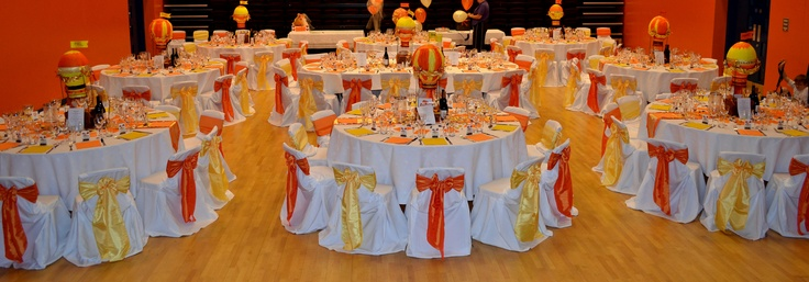Alternating Yellow and Orange Satin Bows on White Chair Covers