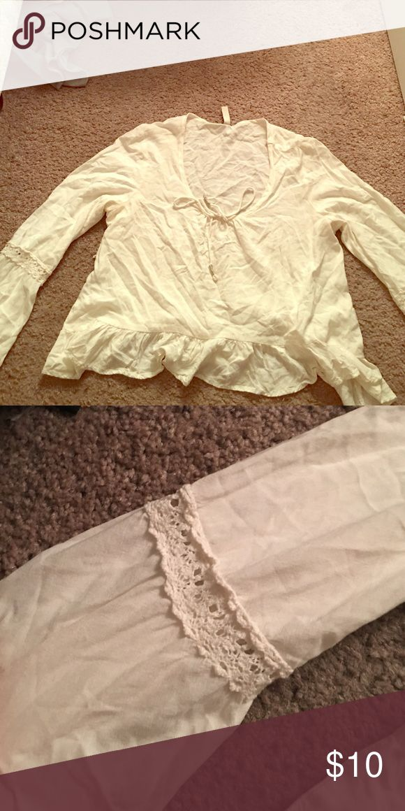 White peasant blouse White peasant blouse with fringe on the bottom, lace design on sleeves. Mudd Tops Blouses