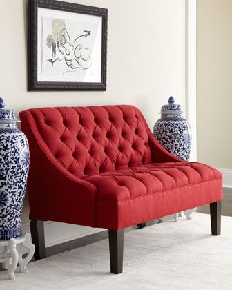 Red Tufted Settee makes a statement in the hallway or foyer